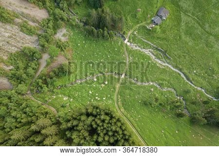 Aerial view of hiking trail over mountain creek in the French Alps