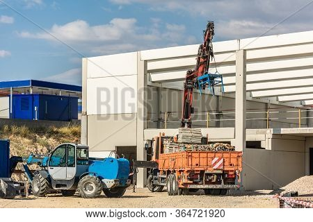 Construction Of A Ship With A Truck Unloading Material For The Structure