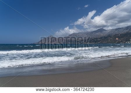 Bay On Crete With Mountain Range, Beach And Sea