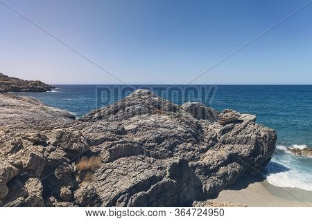 Rocky Bays On Crete With Blue Sea And Sky