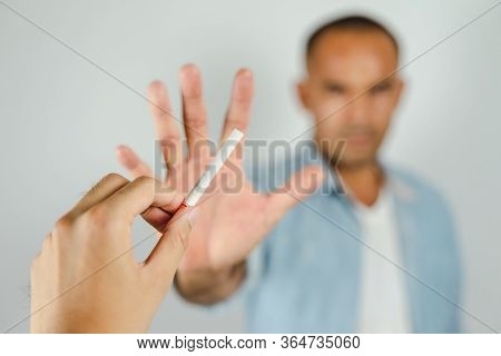 Man Refusing A Cigarettes. Concept Quitting Smoking,world No Tobacco Day.