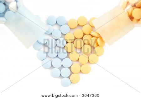 Pills And Drugs Forming Heart On White