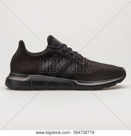 Vienna, Austria - May 27, 2018: Adidas Swift Run Black Sneaker On White Background.