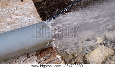 Сlean A Clogged Sewer Pipe. A Plumber Shows How To Clean A Clogged Sewer Pipe Using Cleaning Tool. C