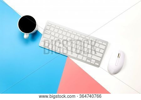 Flat Lay Office Desk Table Of Modern Workplace With Laptop On Blue Pink And White Background, Top Vi
