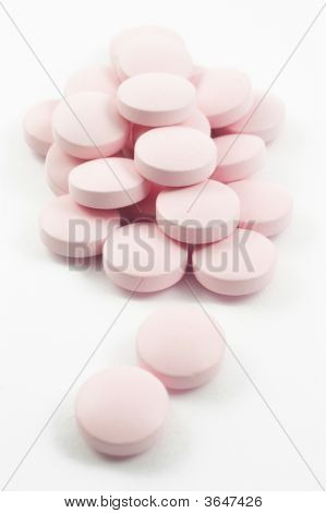 Pink Tablets And Pills Isolated On White
