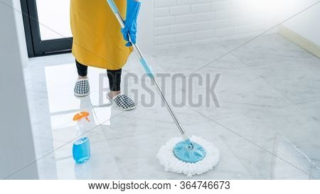 Woman Housekeeper With Mop And Bucket With Cleaning Agents For Cleaning Floor At Home, Floor Care An