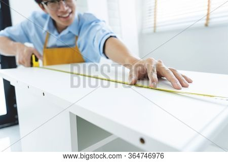 Men's Hands Hold A Measuring Tape Measuring With Flexible Ruler For Home Renovation. Repair, Archite