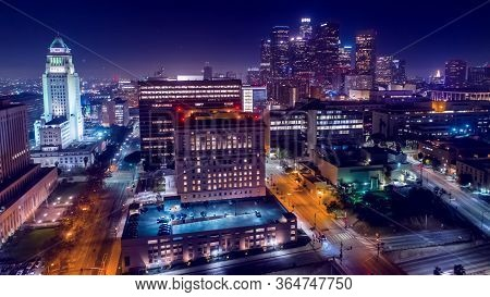 Cinematic Aerial View Of Urban Downtown Los Angeles City Skyline And Streets At Night