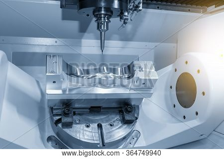 The  5 Axis Cnc Milling Machine Cutting The  Automotive Mold Parts With Solid Ball Endmill Tools. Th