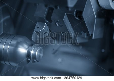 The Cnc Lathe Machine Finish Cutting The Metal Shaft Parts With Cutting Tools For Make The Automotiv