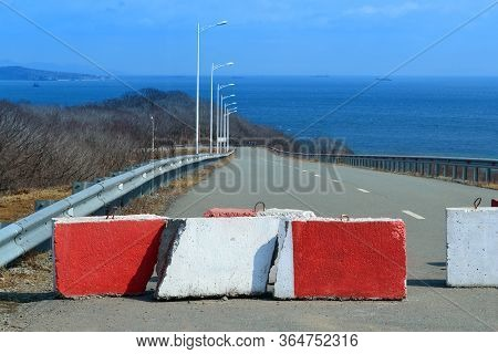 Closed Access To The Sea. Red Concrete Barricade On The Road To The Sea Beach, No Way