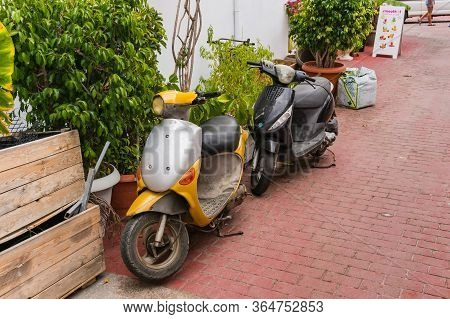 Bali, Crete, Greece - October 7, 2019: Old Vintage Scooters On A Cozy Street Of The Popular Resort O