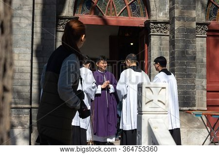 Beijing / China - March 13, 2016: Chinese Catholic Priests At St. Michael Church, Dongjiaoming Stree