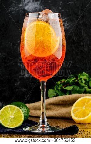 Wineglass With Orange Wine, Mint, Lemon And Lime.