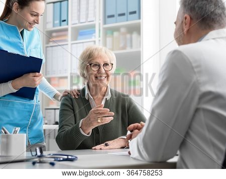 Smiling Senior Woman Meeting The Doctor In His Office
