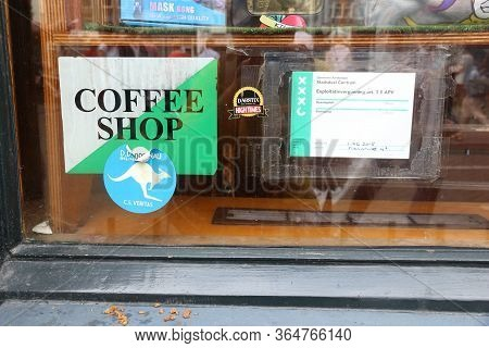 Amsterdam, Netherlands - July 8, 2017: Legal Permit In A Window Of A Coffee Shop In Amsterdam, Nethe