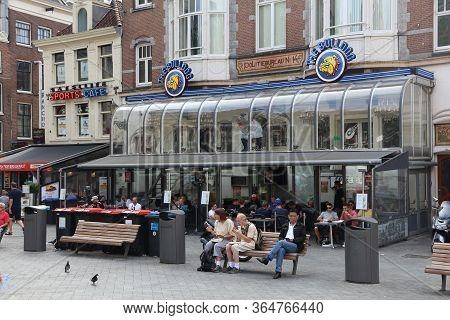 Amsterdam, Netherlands - July 8, 2017: People Visit The Bulldog Coffee Shop In Amsterdam, Netherland