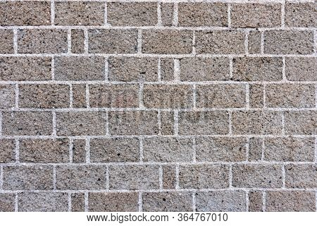 Old gray brick wall background