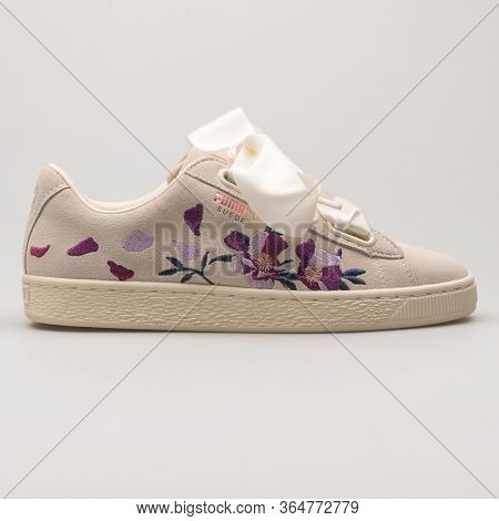 Vienna, Austria - May 27, 2018: Puma Suede Heart Flowery Beige, Purple And Rose Gold Sneaker On Whit