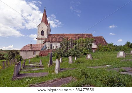 Old Rural Cemetery With Church