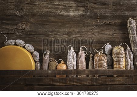 Assortment Of Salami On A Rustic Table