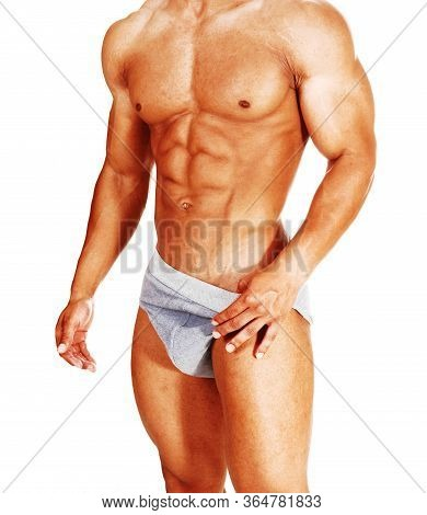 The Torso Of A Young Muscular Young Man Standing In His Gray Underwear Showing His Great Physique, I
