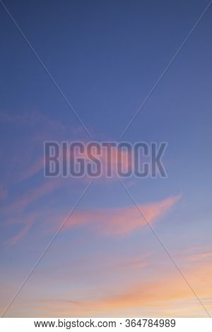 Pink Sunset Clouds And A Blue Sky Background