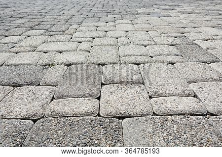 Road Paved With Gray Square Road Tiles