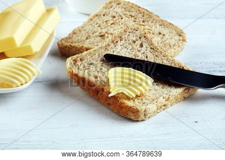 Toasted Bread With Fresh Butter Curls. Margarine Or Spread, Fatty Natural Dairy Product On Breakfast