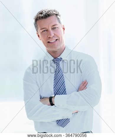 Image of serious business man which posing in studio
