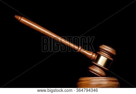 A Gavel On A Pedestal And Isolated Background