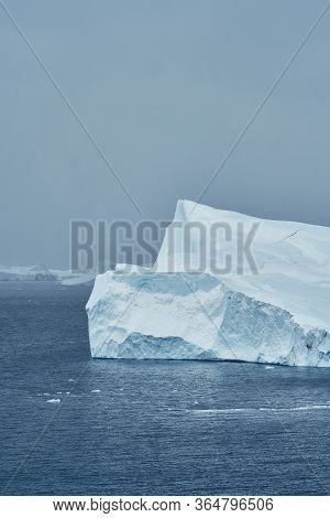 Iceberg At Disco Bay Ilulissat In Greenland With A Gray Sky