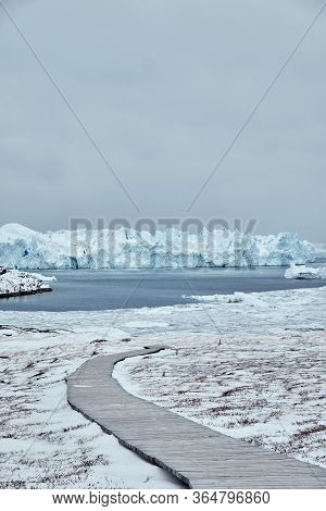 View Of Massive Icebergs In Ilulissat Greenland