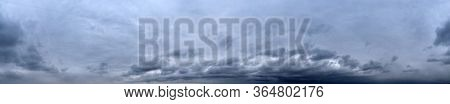 Panorama of cloudy gray sky. Sky rainstorm