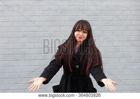 The Beautiful Brunette On The Street In Bewilderment