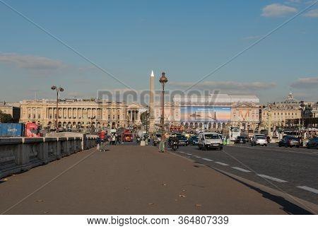 Paris, France, November 7, 2017. Photo Of The Ancient Egyptian Obelisk Amid Traffic On Place De La C