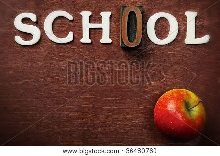 The word school written on wooden background