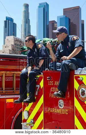 LOS ANGELES, CALIFORNIA, USA - MARCH 3, 2012: Unidentified firefighters watch the people at the Art Festival as a part of security in Los Angeles downtown on March 3, 2012 in Los Angeles, California