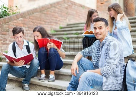 Group of smiling students outdoor portrait