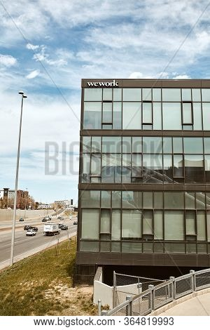 Denver, Colorado - May 1st, 2020:  Exterior Of Co-working Space, Wework Overlooking I-25 Highway, In