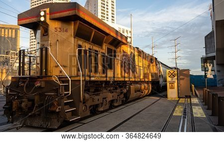 Locomotive Through New Orleans Downtown District On Quiet Morning