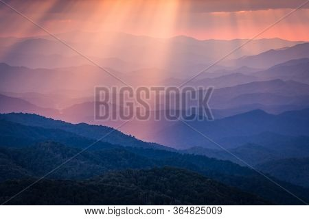 Looking Through Sun Beams Over The Blue Ridge Mountains