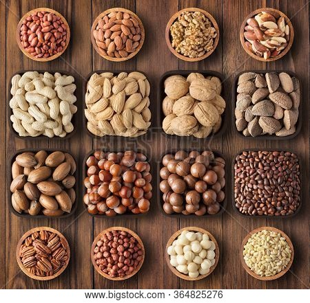 Peeled And Shelled Nuts On Background Wooden Table. Composition Health Food: Pecans, Hazelnuts, Waln