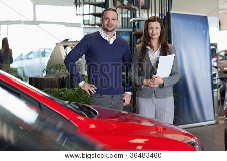Man purchasing a new car in a dealership