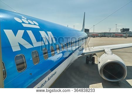 AMSTERDAM, THE NETHERLANDS - CIRCA 2019: KLM airliner at a gate at Amsterdam Schiphol International Airport. Schipol, hub of KLM is one of the busiest airport of Europe