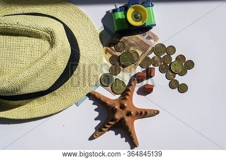 Tourism Related Accessories, Straw Hat, Money, Photo Camera Conceptual Of Aid To The Tourism Sector