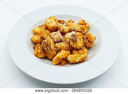 Gnocchi With Ragu Bolognese And Parmesan Cheese. Fresh Pasta Tradition Of Italy.