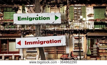 Street Sign The Direction Way To Emigration Versus Immigration