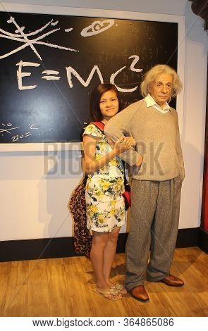 Madame Tussauds Hong Kong - 20 September,2014: The Woman Take A Picture With Albert Einstein Madame